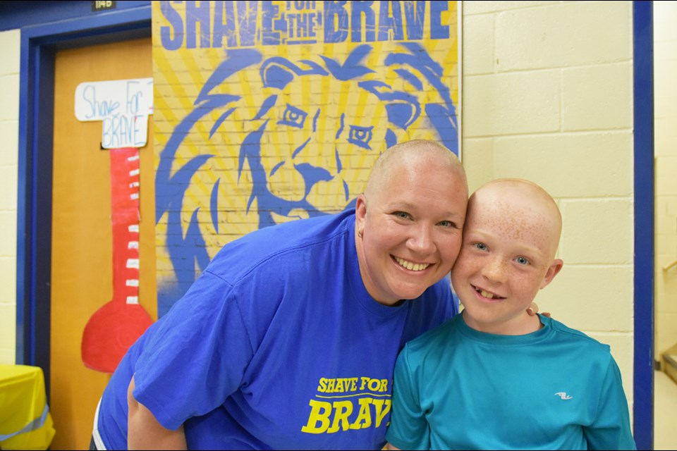 Paula Ferguson and son Bobby both had their heads shaved. Miriam King/Bradford Today