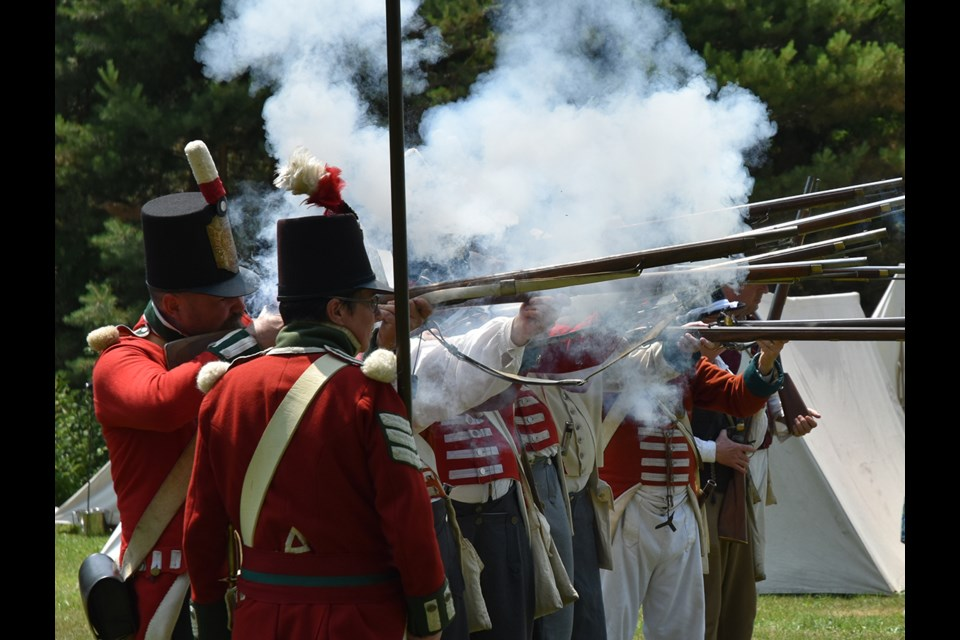 Loyalists advance on the rebels at Montgomery's Tavern in a re-enactment at the Sharon Temple National Historical Site on Canada Day. Miriam King/Bradford Today