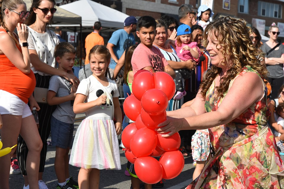 The Twisted Ones entertained with their balloon artistry - here, giving away a really big balloon dog. Miriam King/Bradford Today