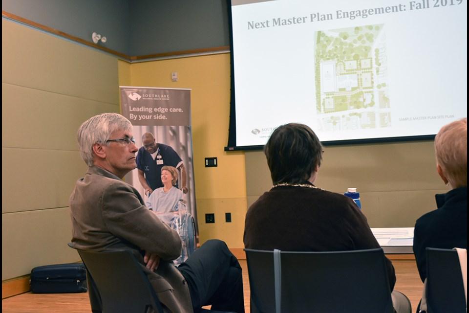 Residents, including BWG Mayor Rob Keffer, at left, listen to a presentation on Southlake Regional Health Centre's Strategic Planning. Miriam King/Bradford Today