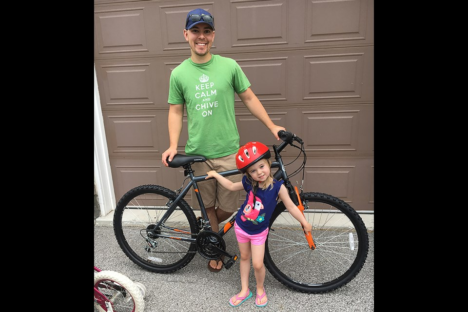 Jon Davies won a bike at Carrot Fest, to the delight of the family. Submitted photo
