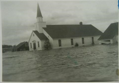 Springdale church, west of Highway 400, stands in the floodwaters. Photo: BWG Public Library Archives
