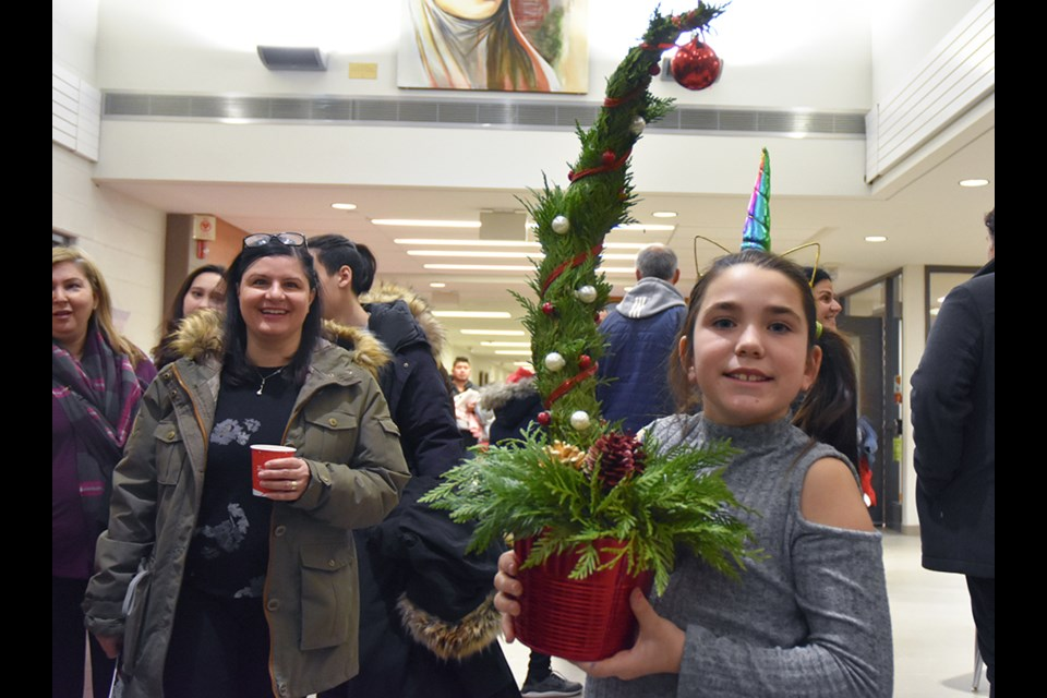 Picking up a 'grinch tree,' at St. Angela Merici Catholic elementary school's Christmas Bazaar. Miriam King/BradfordToday