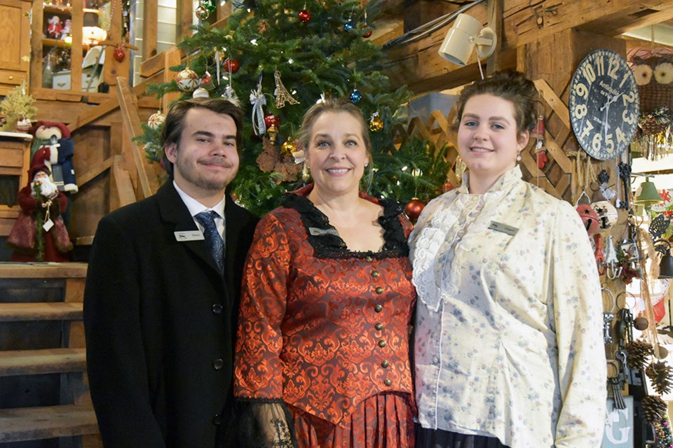 Diana Robinson, centre, with daughter Abigail and son Owen, celebrating a Victorian Christmas at the Cookstown Antique Market. Miriam King/BradfordToday