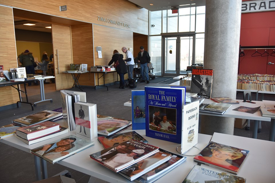 Book lovers paid a premium for hard-cover and coffee table books; most were priced at $2. Miriam King/Bradford Today