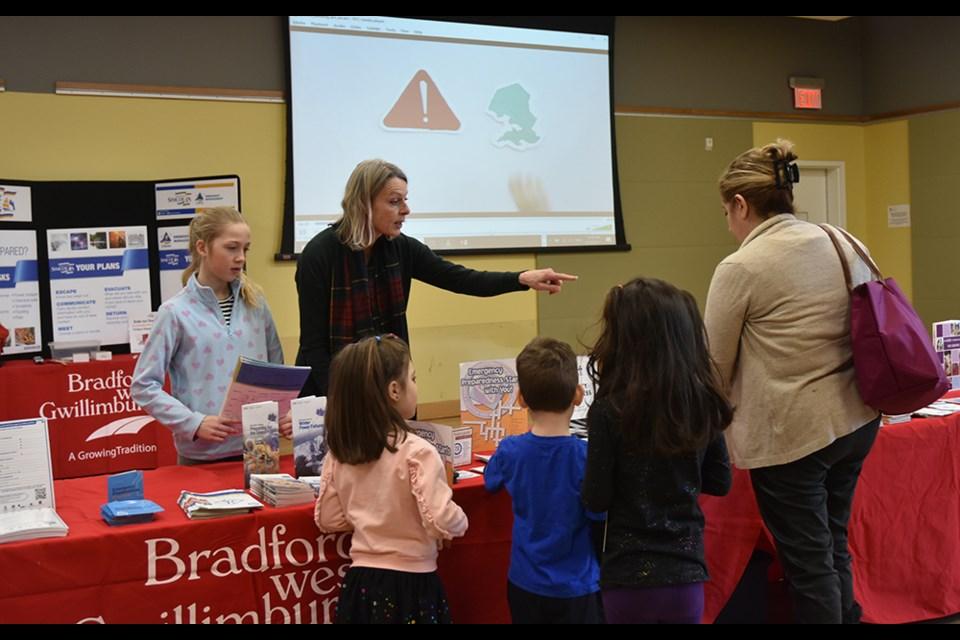 Astrid Vig-Bergsma and a helper provide information on emergency preparedness at the Bradford Public Library. Miriam King/Bradford Today