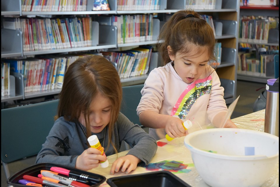 These kids enjoyed making art with glue and tissue paper, at the BWG Public Library Monday as March Break activities kicked off. Miriam King/Bradford Today