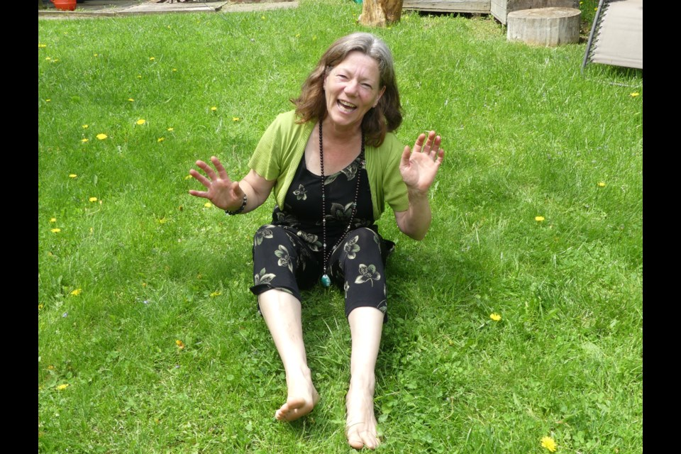 Cathy Nesbitt teaches laughter yoga in her backyard every Sunday throughout the summer. Jenni Dunning/BradfordToday