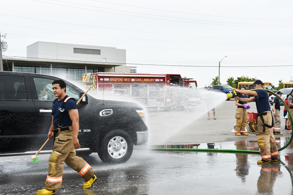 Volunteer firefighters hold their annual fundraising car wash at Canadian Tire in Bradford on June 9. Miriam King/Bradford Today