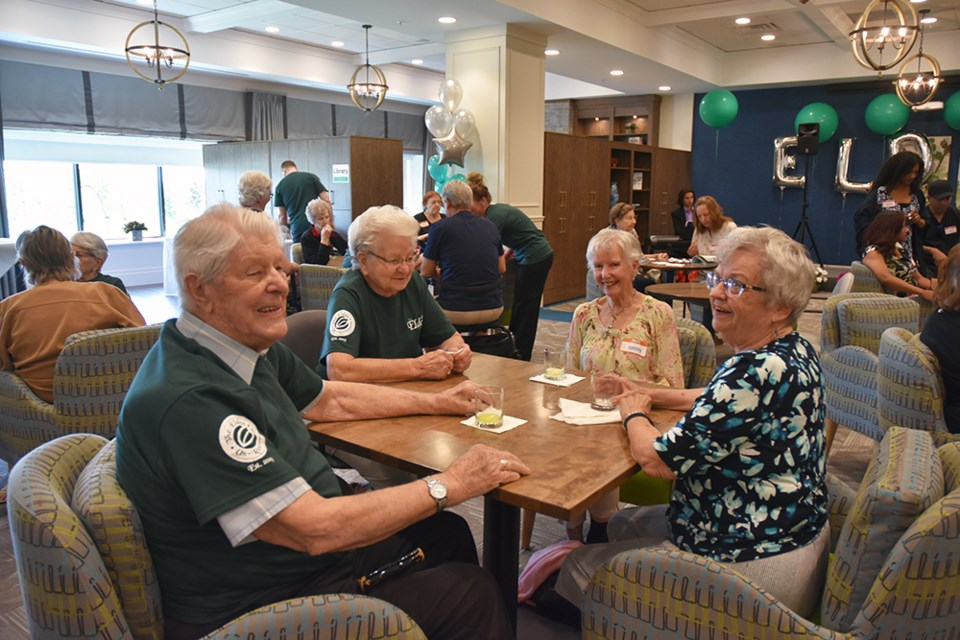 Residents and staff donned green t-shirts for The Elden's Grand Opening on Saturday. Miriam King/Bradford Today