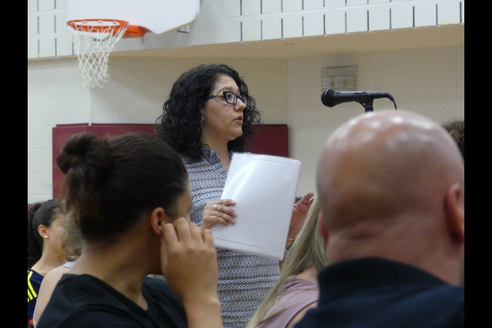 A parent expresses her concerns about students in portables during the June 7 hold and secure. Jenni Dunning/Bradford Today
