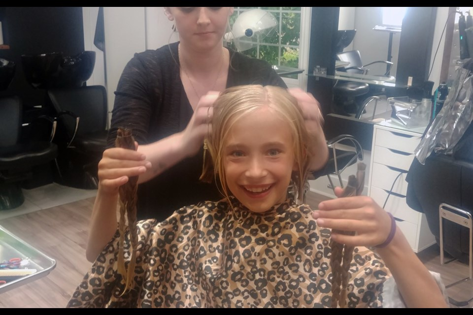 Adriana Verkaik with her new short haircut and the tresses she will donate to Pantene Beautiful Lengths, to make wigs for cancer patients. Submitted photo
