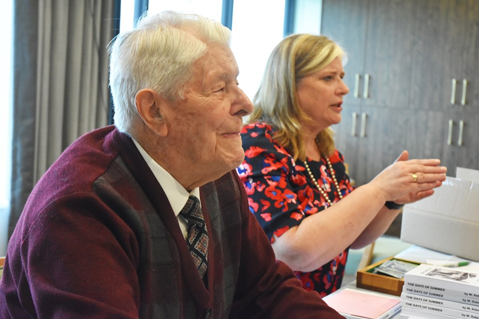 Author Bob Sturgeon, 95, and daughter Heather chat at the launch of The Days of Summer, Sturgeon's newest book. Miriam King/Bradford Today
