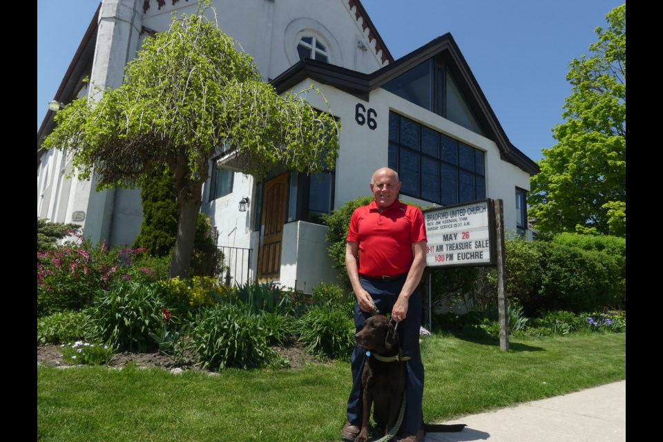 Bradford United Church Rev. Jim Keenan, with dog O'Malley, said the Barrie Street church will host a celebration June 10.