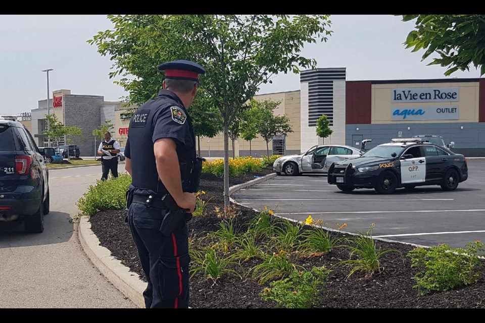 South Simcoe Police investigate after a hit-and-run crash turned into an arrest at Tanger Outlets in Cookstown. Sue Sgambati/South Simcoe Police