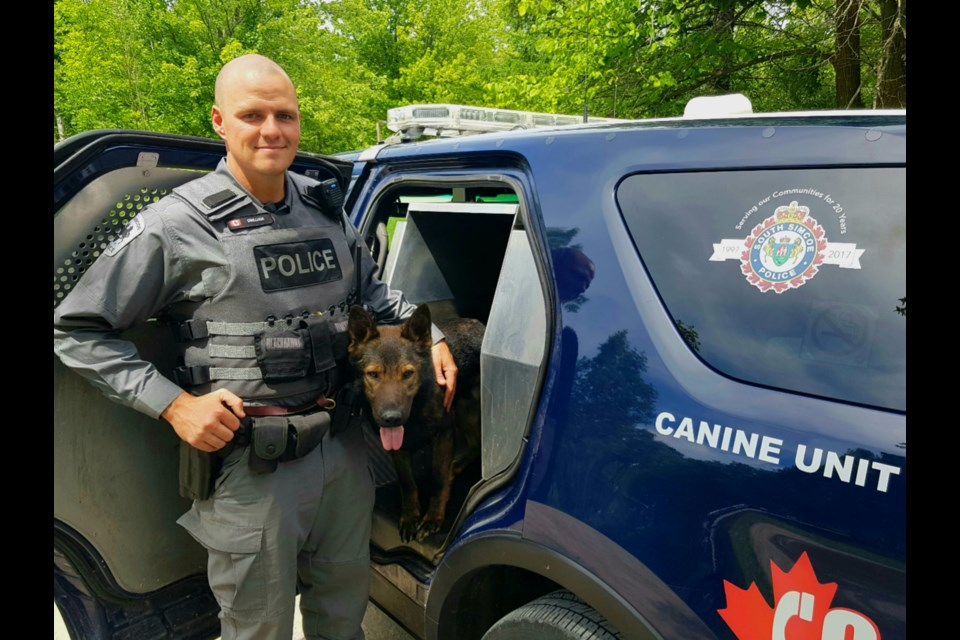 South Simcoe police Const. Shawn Gwilliam and Nitro the police dog. Submitted photo