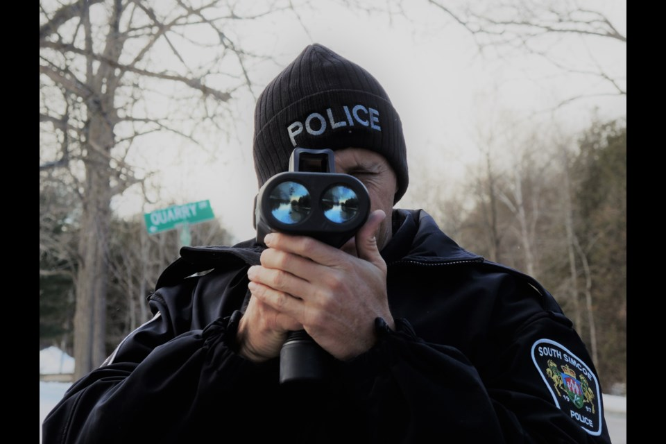 South Simcoe Police Const. Paul Catling, pictured with a radar gun, said officers make more stunt driving charges when warmer temperatures arrive for spring. Submitted photo
