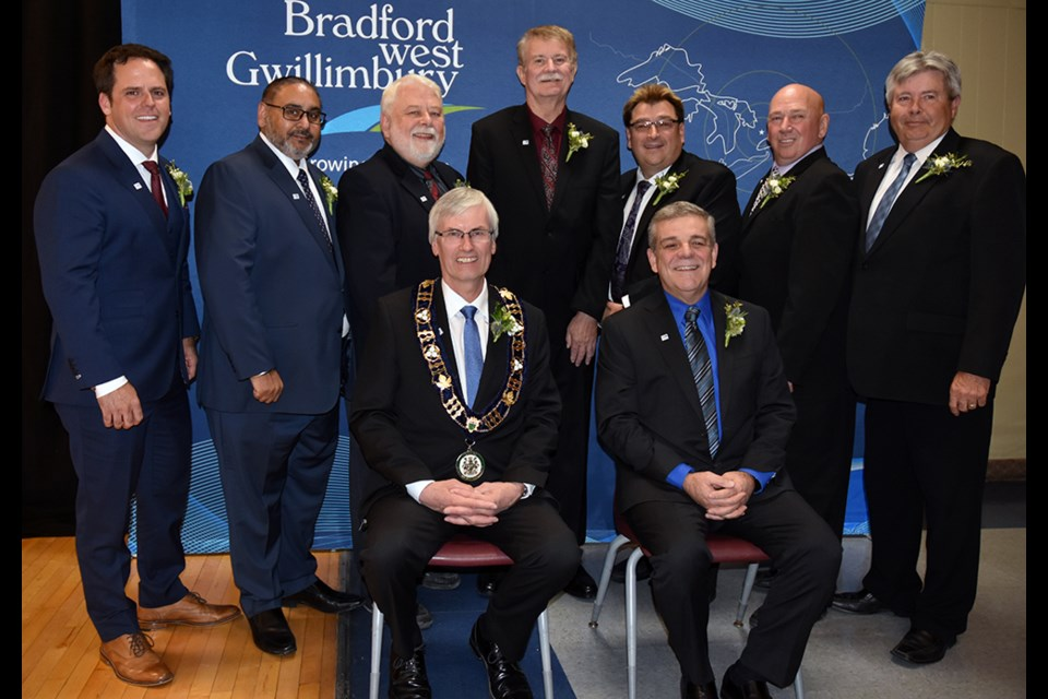 The newly sworn-in council. Front: Mayor Rob Keffer, left, and Deputy Mayor James Leduc. Standing, from left: Peter Ferragine, Raj Sandhu, Gary Lamb, Gary Baynes, Peter Dykie Jr., Mark Contois, Ron Orr. Miriam King/Bradford Today