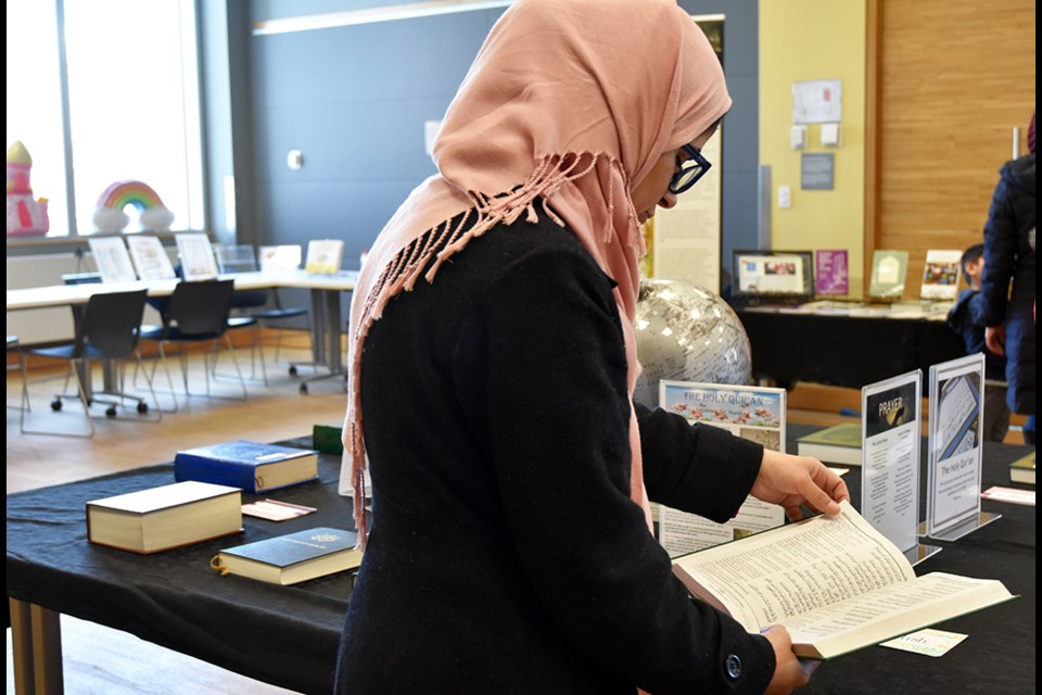 Aisha Tasneem reads a translation of the Holy Quran, at the Bradford Library. Miriam King/Bradford Today