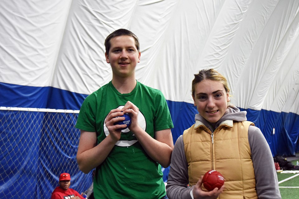 Representing Barrie North Collegiate, Special Olympics athletes Emily Craig and Chris Quinn practice bocce at the Bradford Sports Dome. Miriam King/Bradford Today