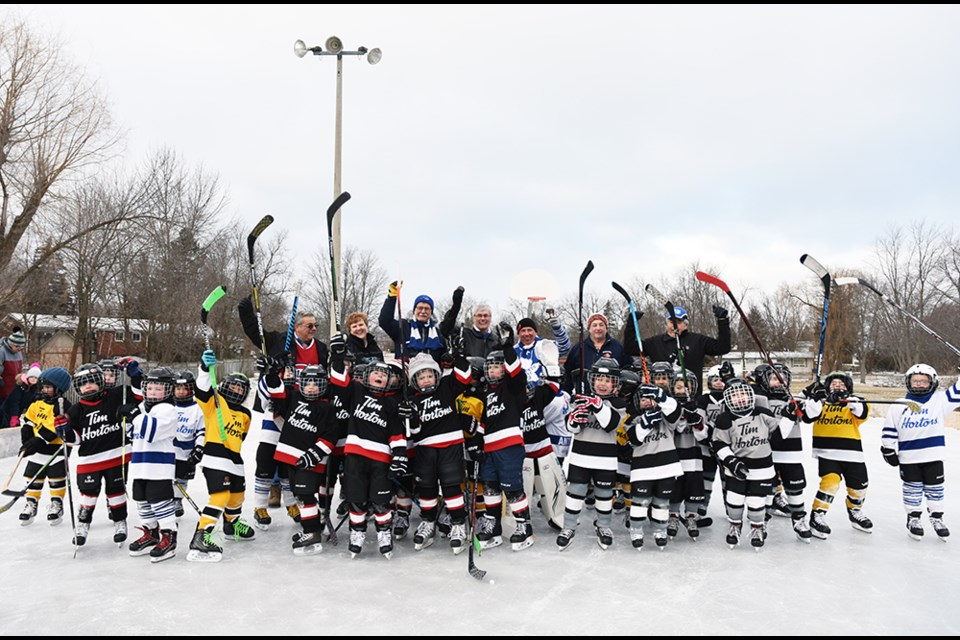 Members of BWG Council, including Mayor Rob Keffer and Deputy Mayor James Leduc, join young IP Hockey players for the start of Hockey Day in BWG, Feb. 9. Miriam King/Bradford Today