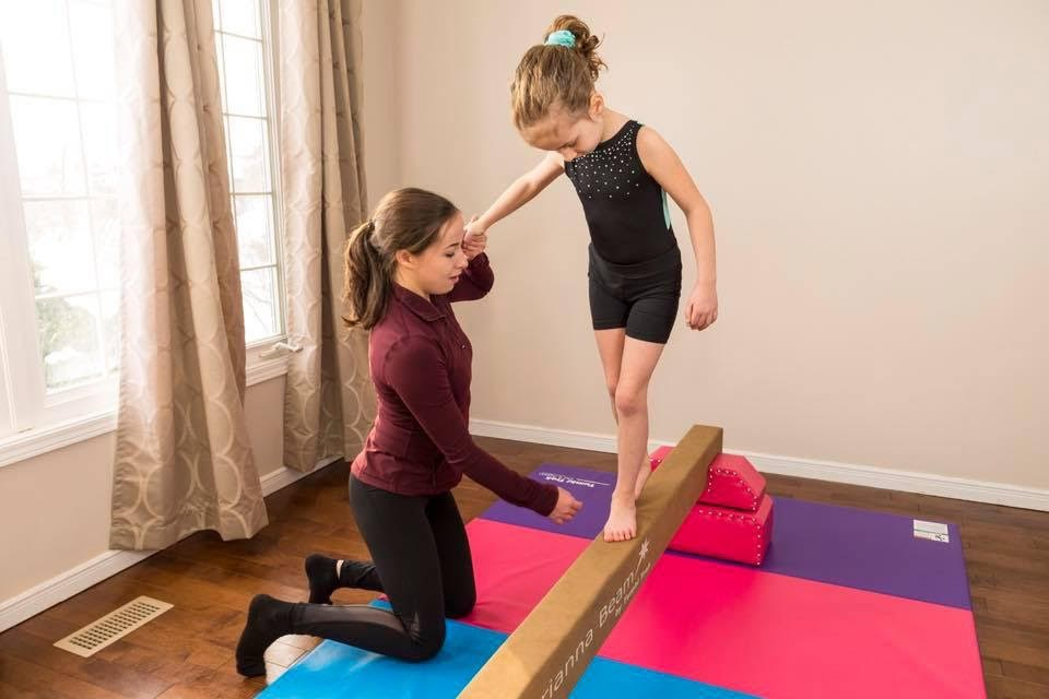 Alexa Doucet works with a gymnastics student one-on-one. Submitted photo
