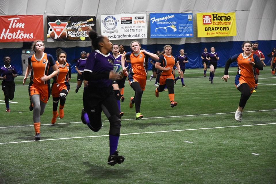 Innisdale girls in pursuit of the St. Roch team, in possession of the ball. Miriam King/Bradford Today