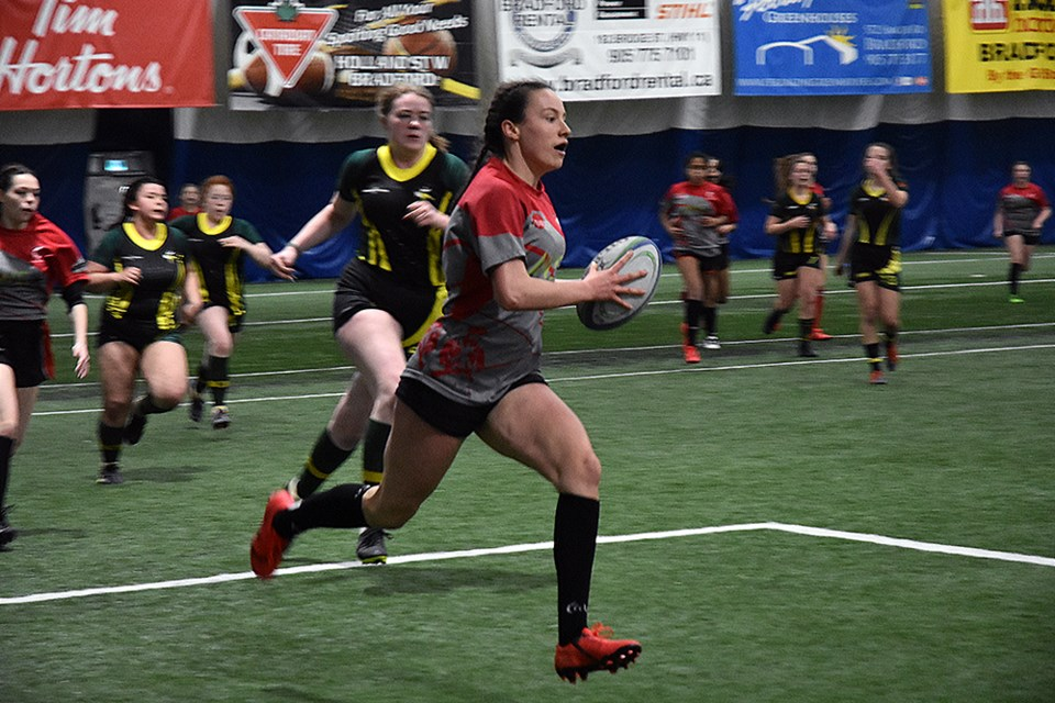 Guelph player heads toward the try line, in Jr. Girls Rugby action against the Barrie North Vikings. Miriam King/Bradford Today