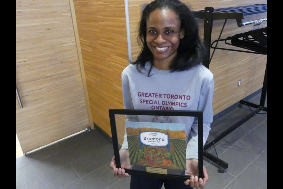 Monique Shah with a painting given to her by BWG council to honour her contributions to Special Olympics. Jenni Dunning/BradfordToday