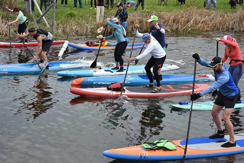 Stand-up paddleboarders had their own class at the 41st annual Marsh Mash marathon races in Bradford Saturday. Miriam King/Bradford Today