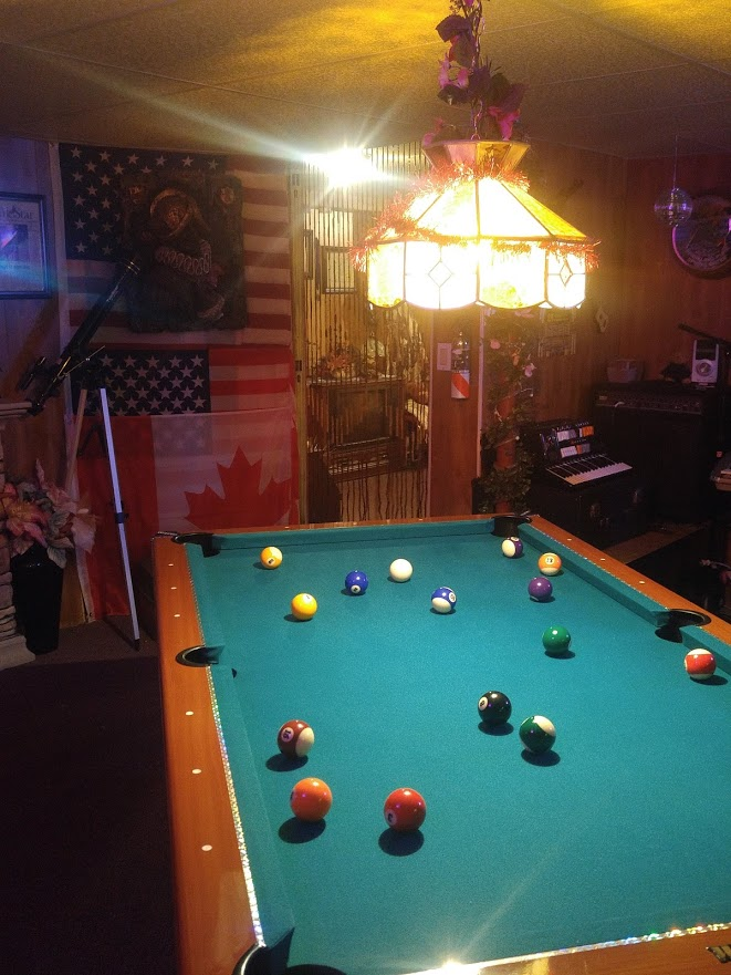 This Is Beautiful Legal Size Pool Table With All Necessary Items Such As  Balls And Cues(6 In Total Cues) In My Games Room At My Home.