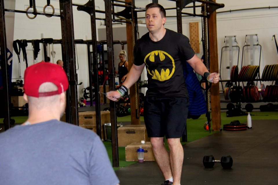 Collingwood firefighter Chris Heath competes in the worldwide CrossFit Open challenge Saturday at CrossFit Indestri in Collingwood. Gisele Winton Sarvis/Collingwood Today
