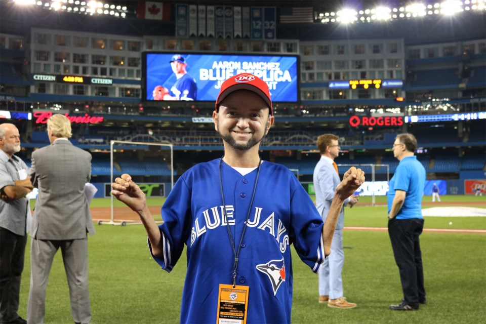 Raymond Hardisty on the field at the Blue Jays game Aug. 8. Dairy Queen Canada photo