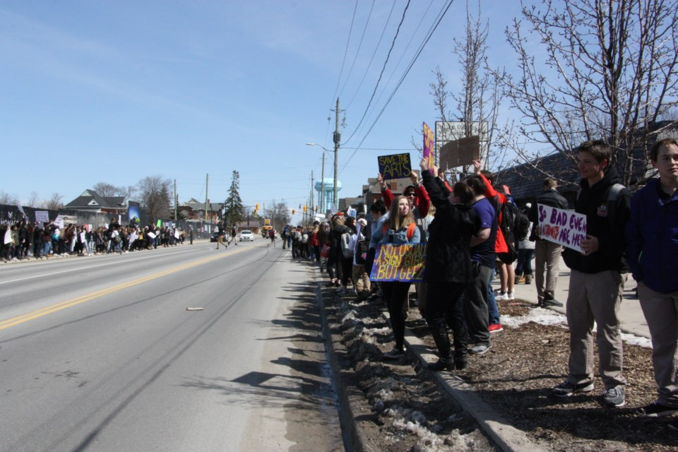 Students line Hume Street during the walk-out protest this afternoon. Erika Engel/CollingwoodToday