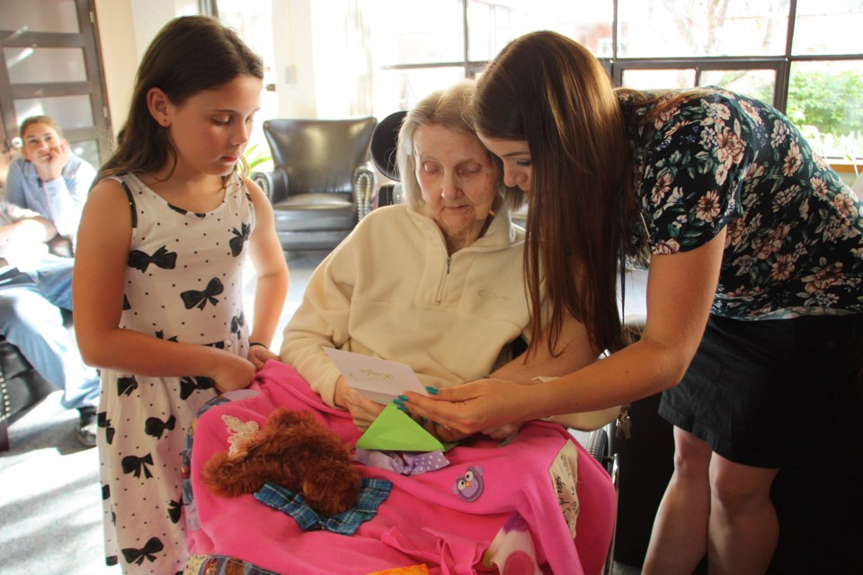 Kayla MacNeil, the youngest of the seamstresses, made a fidget blanket for Jesse. Activationist Katie Goodine helped Kayla present the blanket and read the card Kayla made to go with the blanket. Erika Engel/CollingwoodToday