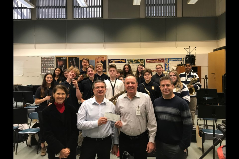 Ruth and Charlie Gudaitis present Jean Vanier Catholic High School music teacher Gregory Frackowiak and Principal John Collingbourne with $1,500 for the high school music program from the South Georgian Bay Music Foundation. Contributed Photo