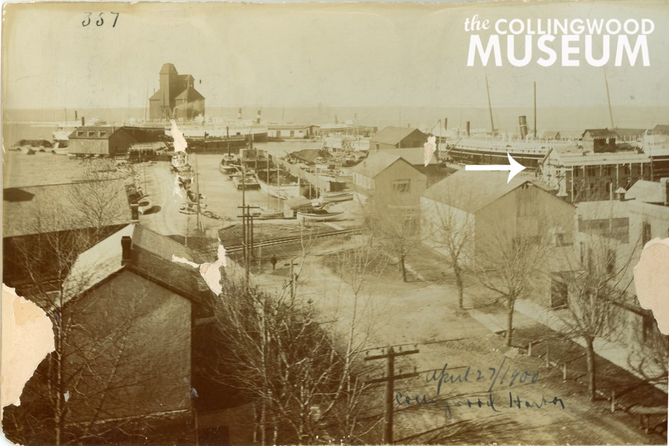 This photograph dated 1900 appears to show construction or renovation of the white two-and-a-half storey building. Photo contributed by Collingwood Museum. Huron Institute 357 and 895, Collingwood Museum Collection X969.240.1, X974.758.1