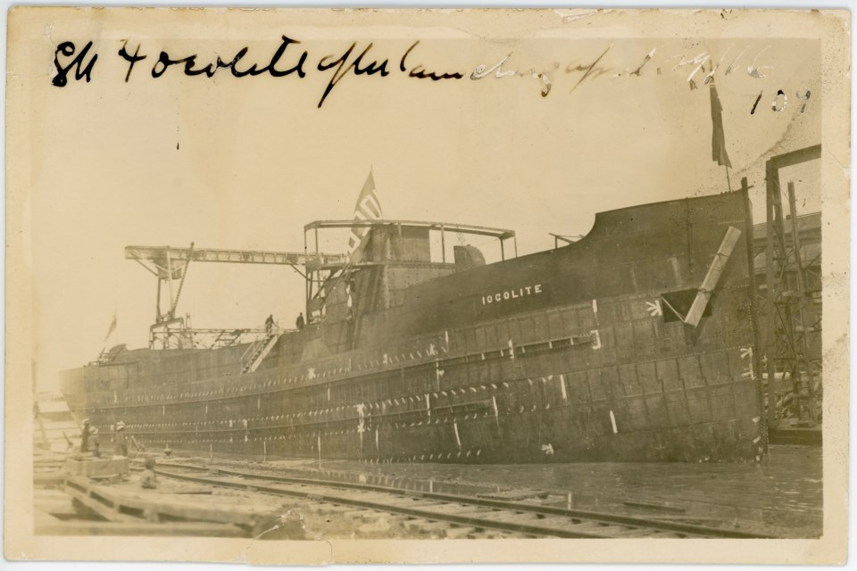 The Iocolite sits with an unpainted hull in Collingwood's harbour. It launched in April, 1916. Huron Institute 109; Collingwood Museum Collection X974.627.1