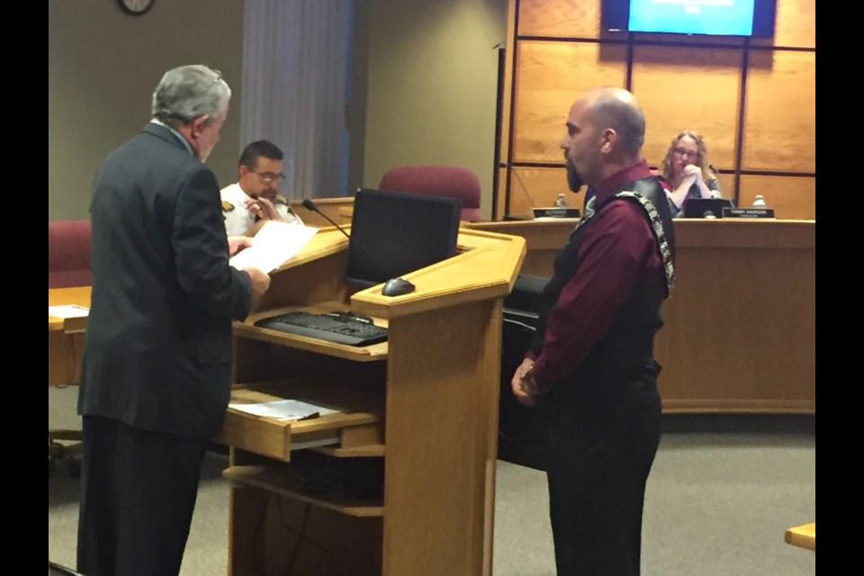 Ed Pearce being sworn in as city councillor by Mayor Dan Marchisella.