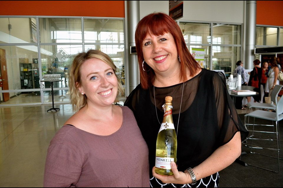 Rhyze Program front of house coordinator Bailey Morrison and director Kristel Manes uncork some non-alcohol champagne to get things started. Troy Bridgeman for GuelphToday.com