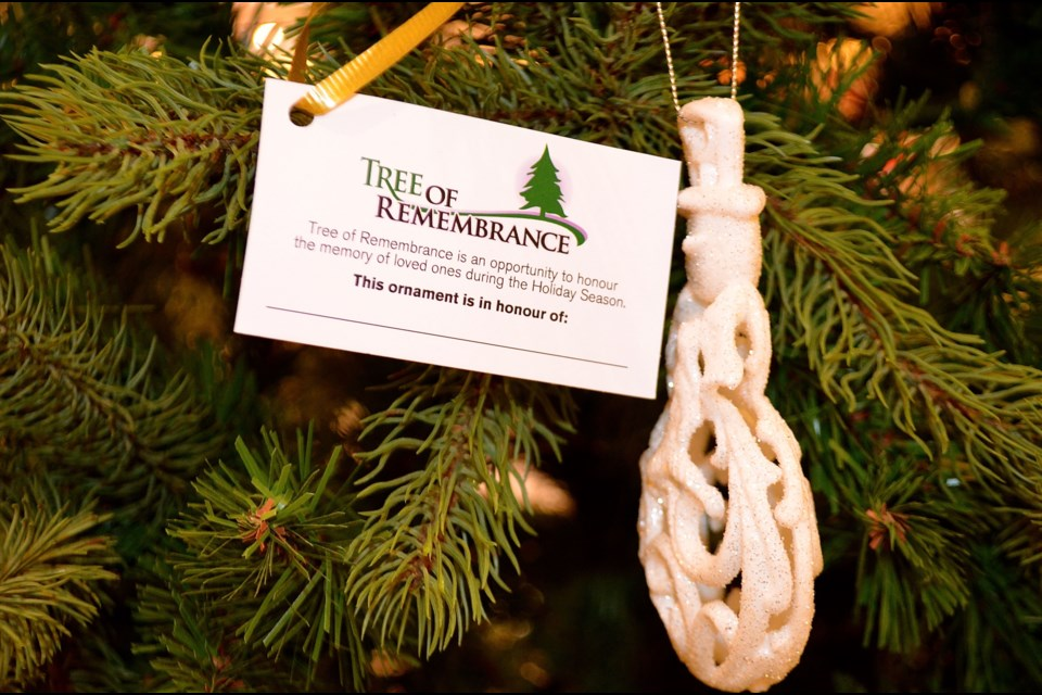 a tag and ornament on hospice wellingtons tree of remembrance in stone road mall troy - Christmas Decorations In Memory Of A Loved One