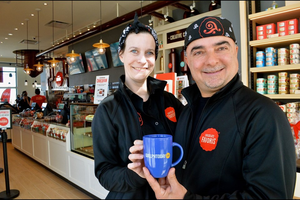 Store manager Nancy Zajac and director of operations for Ontario and Western Canada Lou Struminikovski from Chocolats Favoris during the soft opening of their new location in Clair Marketplace.