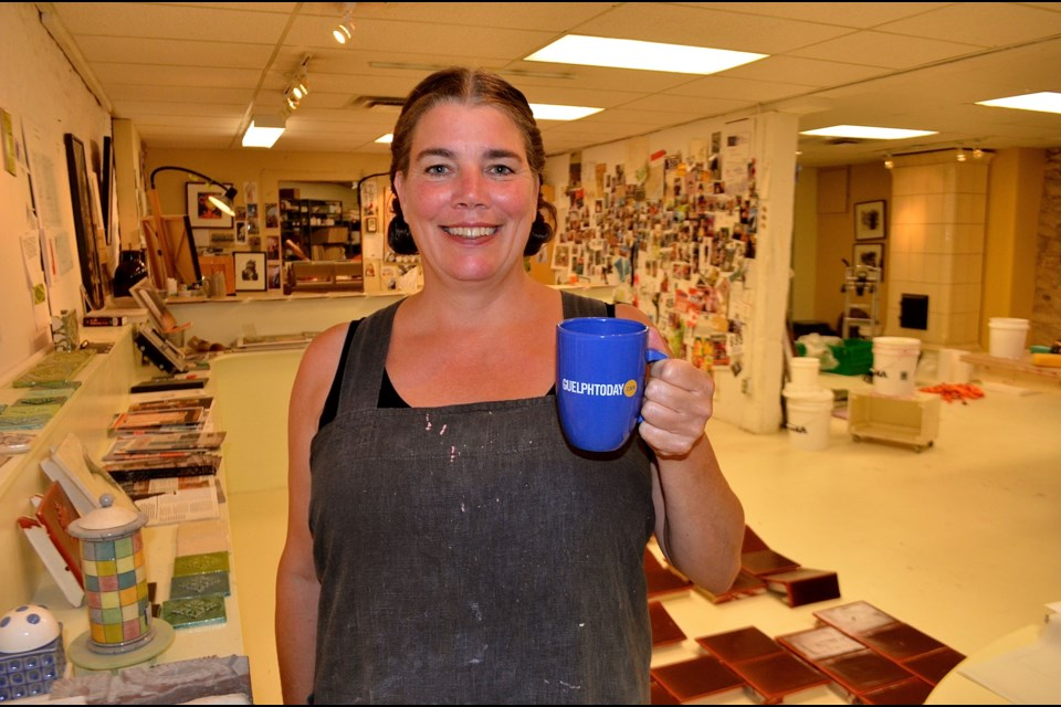 Potter and oven maker Jessica Steinhauser in her studio on Woolwich Street.  Troy Bridgeman for GuelphToday.com