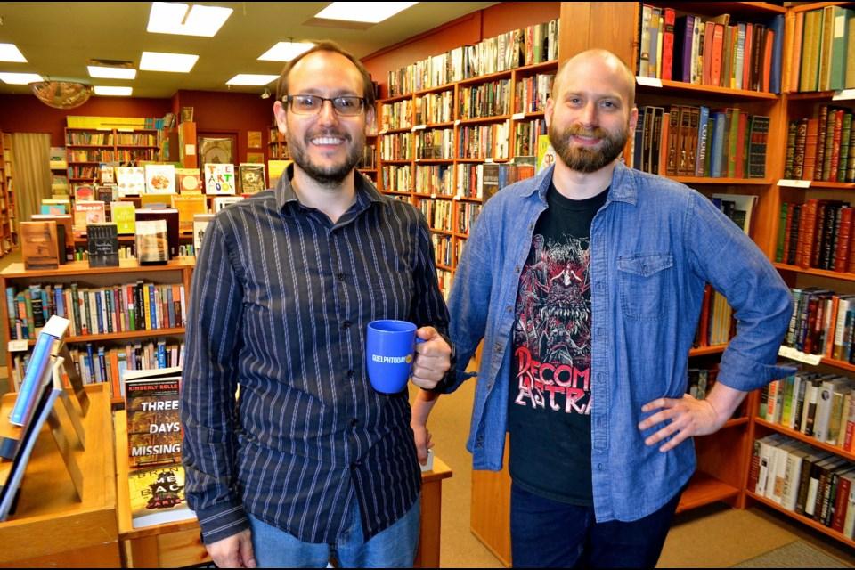 Janus Books owner Kieran Dunn with staff member Andrew Meek.  Troy Bridgeman for GuelphToday.com
