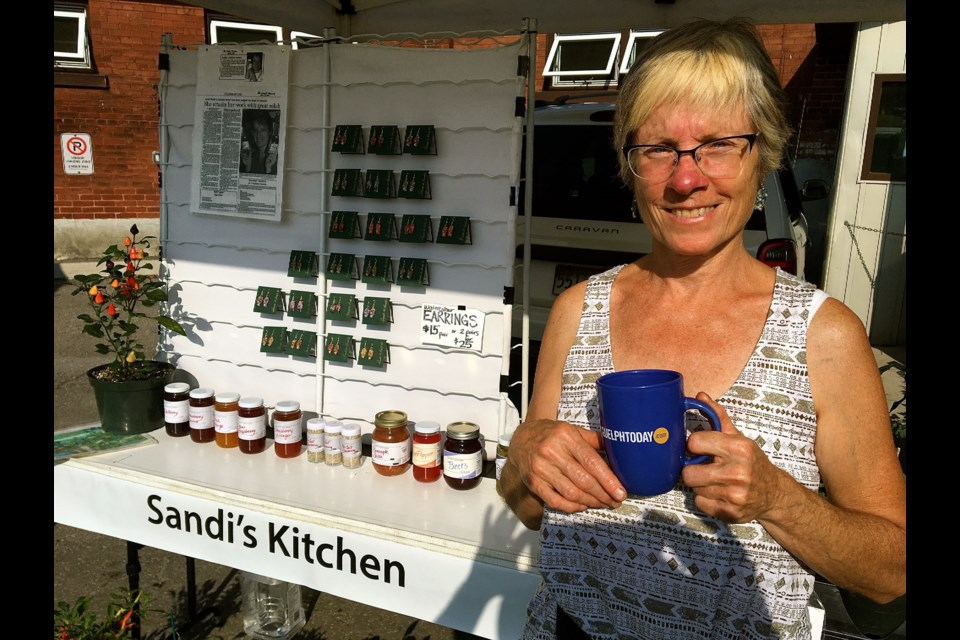 Sandi Huish owner of Sandi's Kitchen at her stand in the Guelph Farmers Market. Troy Bridgeman for GuelphToday.com