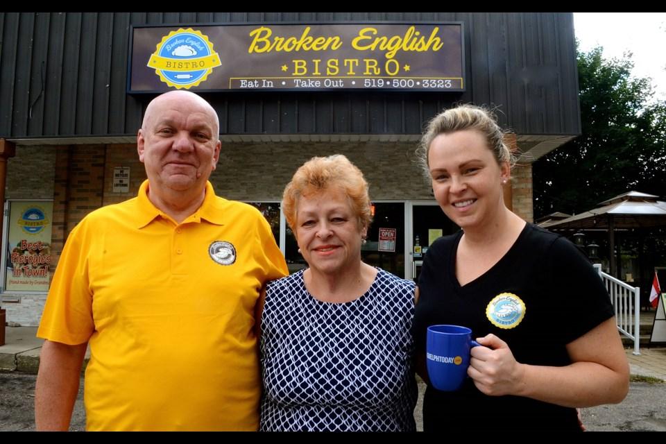 Edward, Danuta and Dominika Rusiecki outside their Broken English Bistro on Speedvale Avenue East. Troy Bridgeman for GuelphToday.com