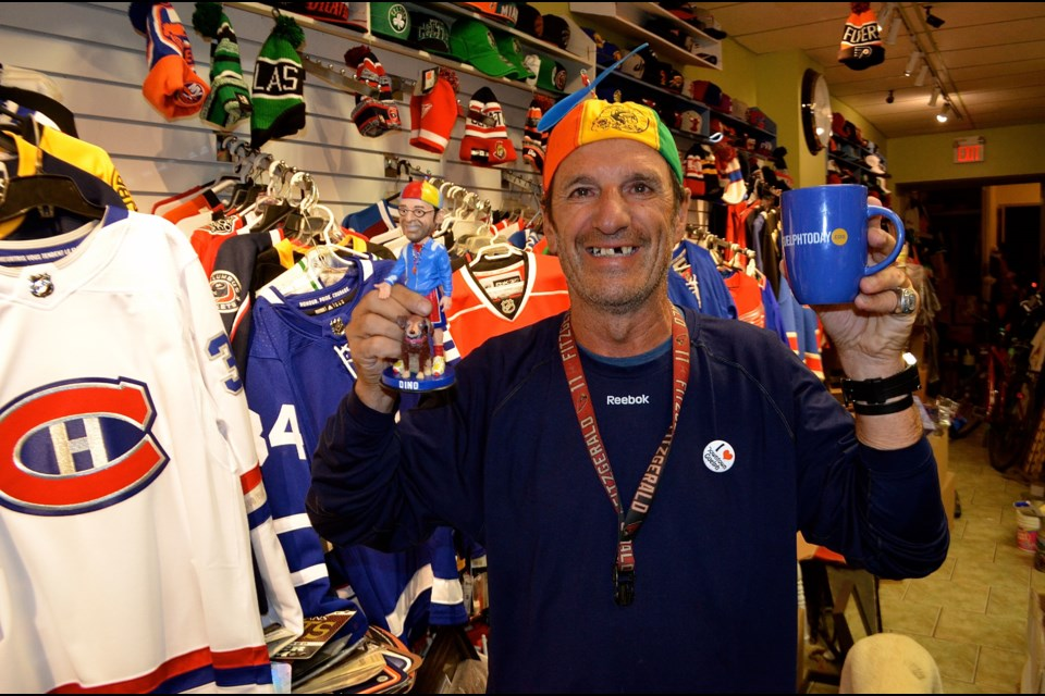 Dino Scrementi owner of Dino's Athletic Direct with one of his custom collectable bobble head figurines.  Troy Bridgeman for GuelphToday.com