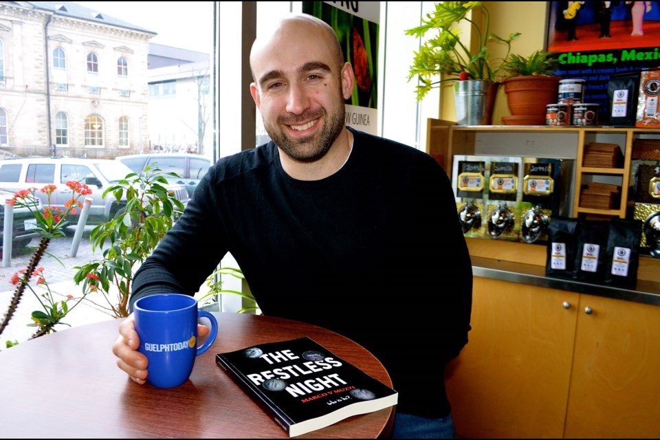Author Marco Muzzi at Planet Bean downtown Guelph where he wrote most of his murder-mystery novel, 'The Restless Night'. Troy Bridgeman for GuelphToday