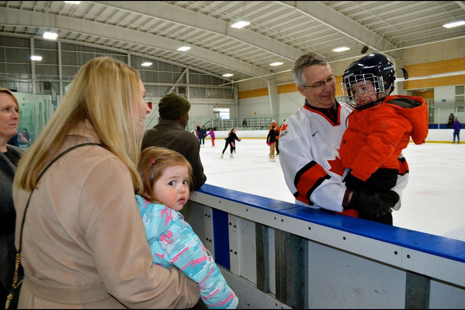 99f4313ac45 Guelph MP Lloyd Longfield takes his grandson Michael for a spin around the  rink during the