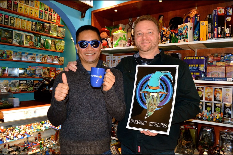 Joem Figueroa and Jamie Doran are rescuing old toys and giving them new homes at the Freaky Wizard toy store in the Afterlife gaming lounge downtown on Wyndham Street. Troy Bridgeman for GuelphToday.com